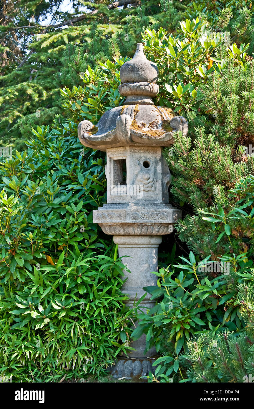 This concrete pole is a Japanese style decor in a garden setting ...