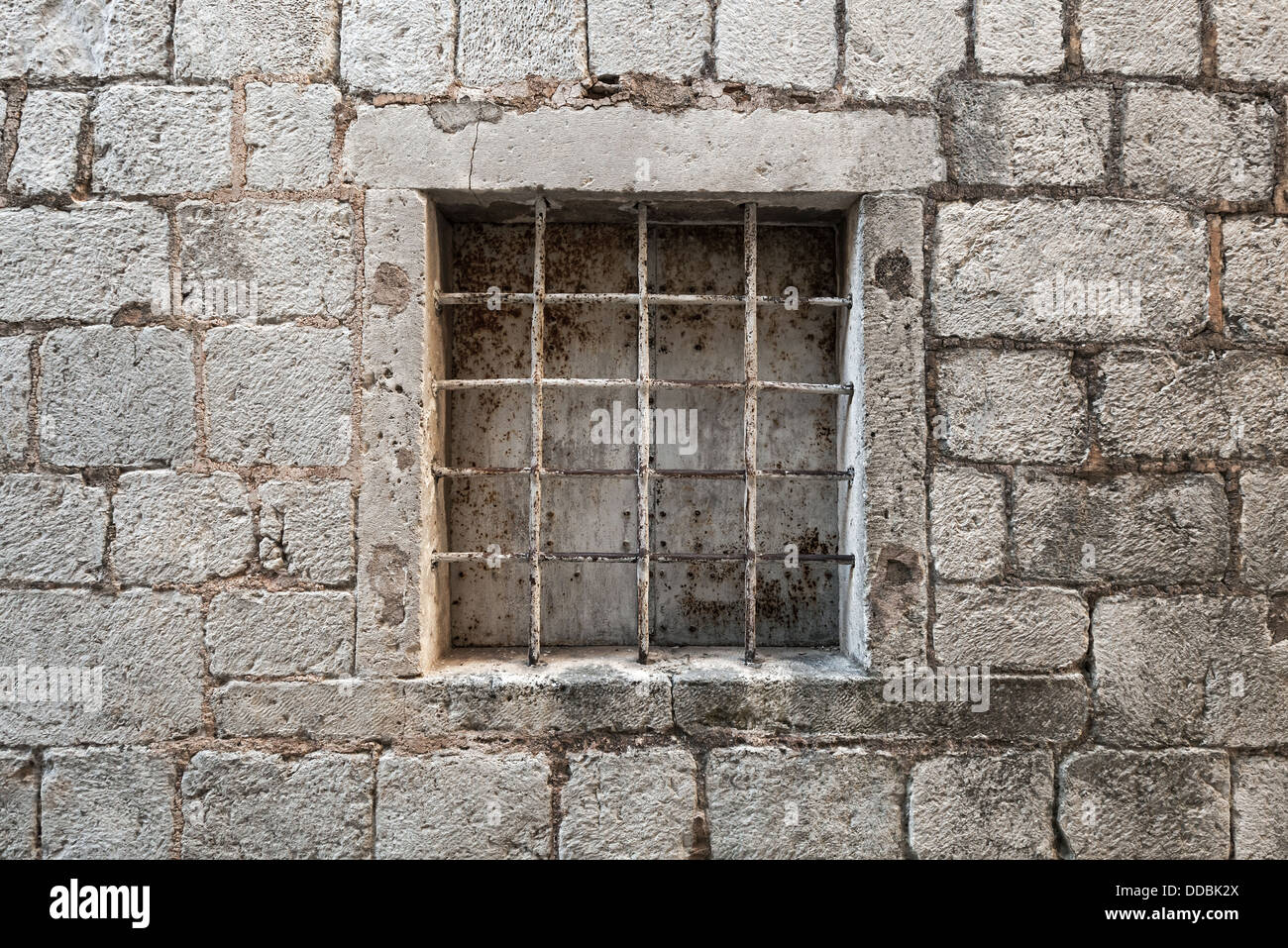 Locked ancient stone prison wall with metal window bars ... Prison Wall Texture