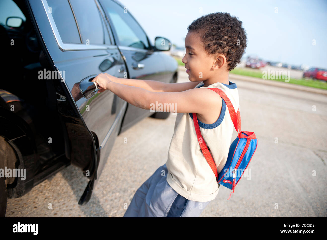 A young boy playing, pulling a car door open Stock Photo, Royalty ...