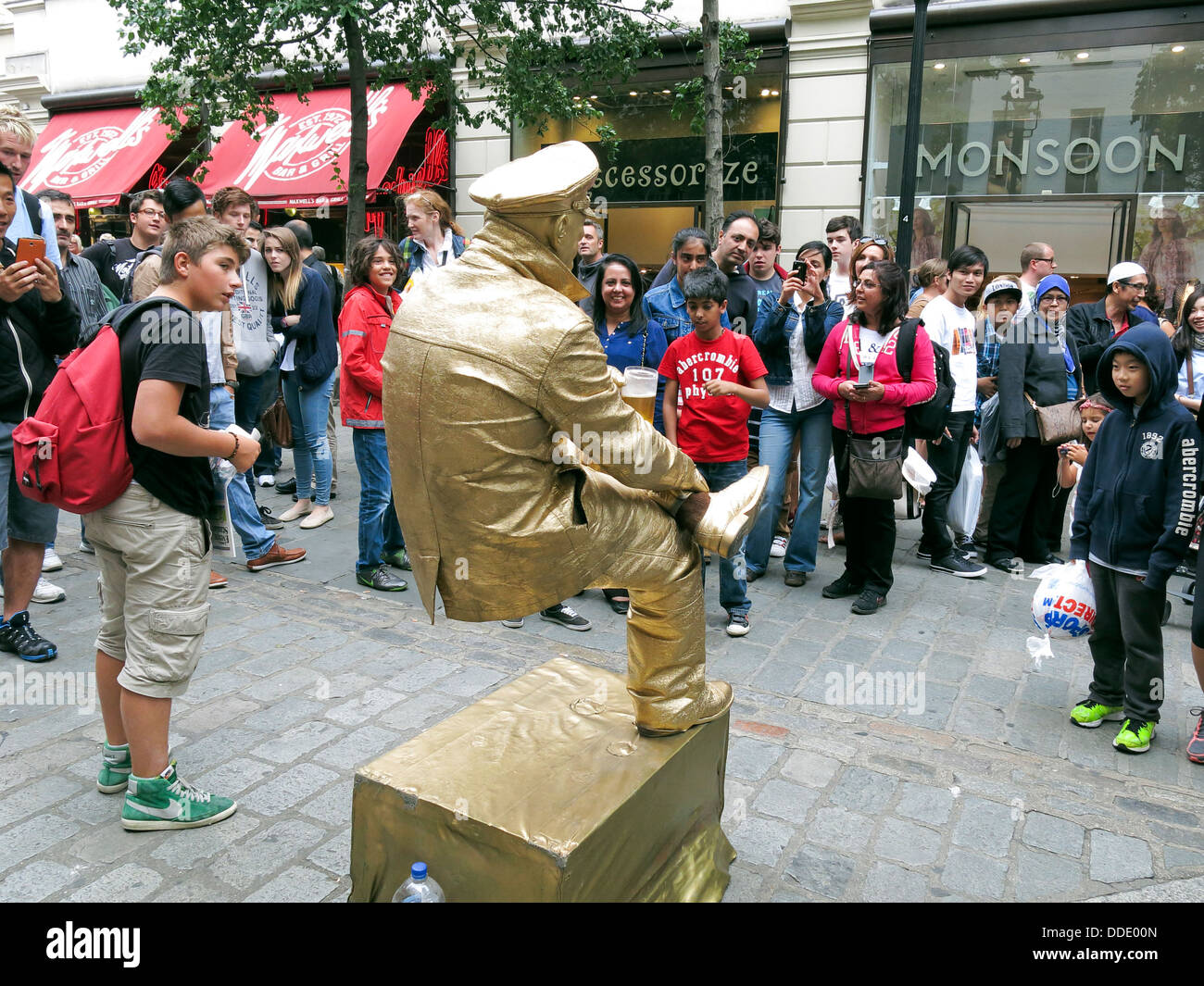 street performer busker dressed in gold sitting on an invisible chair stock photo 59928981 alamy. Black Bedroom Furniture Sets. Home Design Ideas