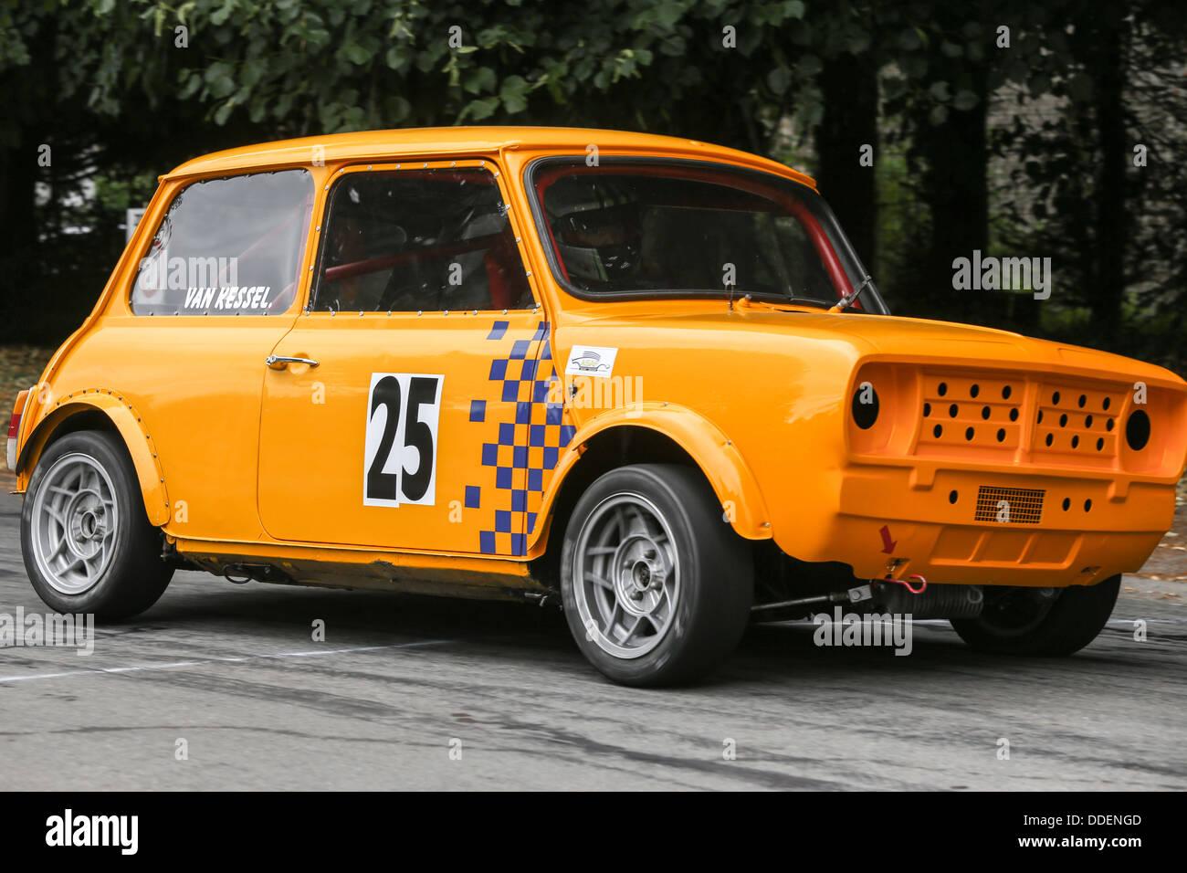 Orange mini cooper rally car on a slalom race Stock Photo, Royalty ...