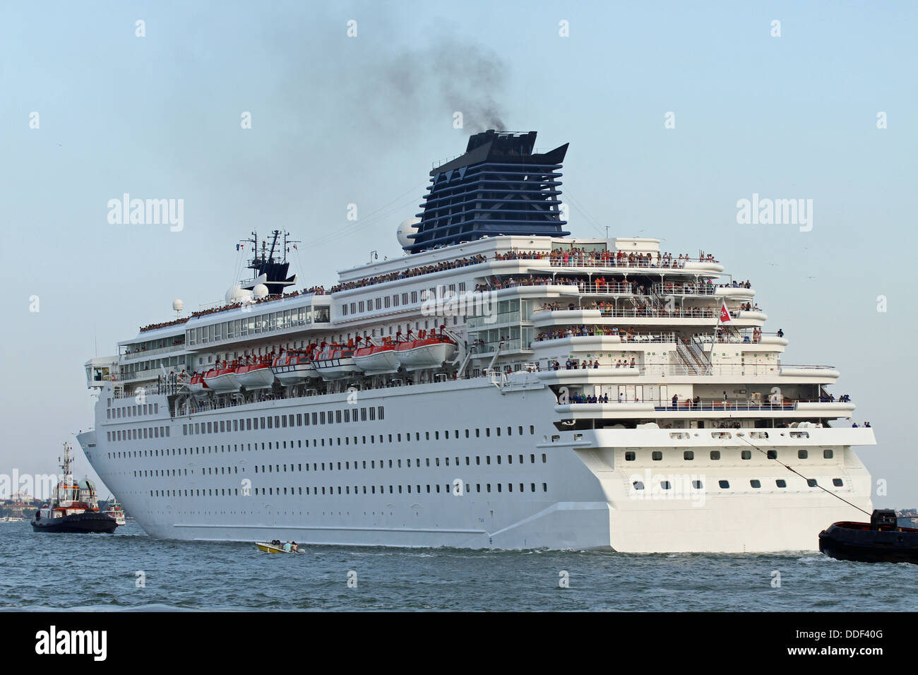 Huge Cruise Ship Leaves The Port City With The Help Of Powerful - Huge cruise ship