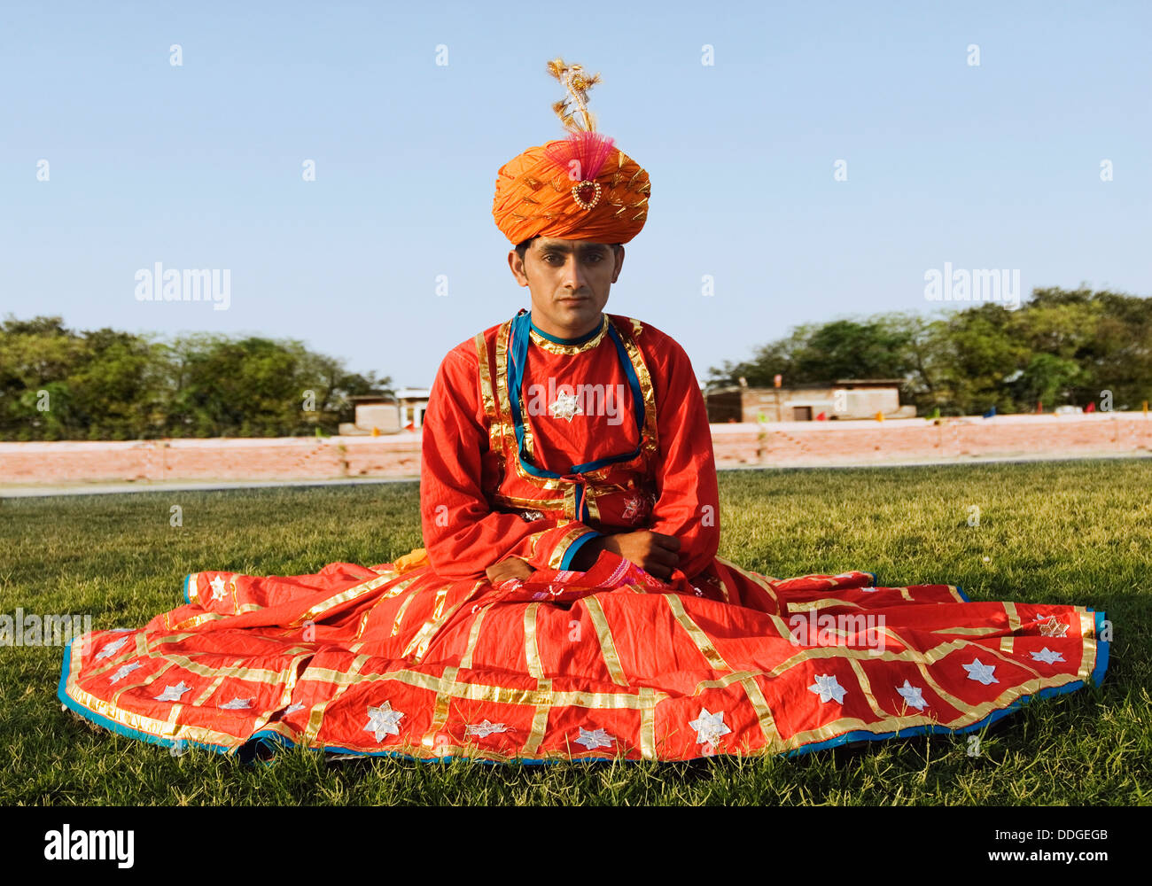 Portrait of a man in traditional Rajasthani dress sitting ...