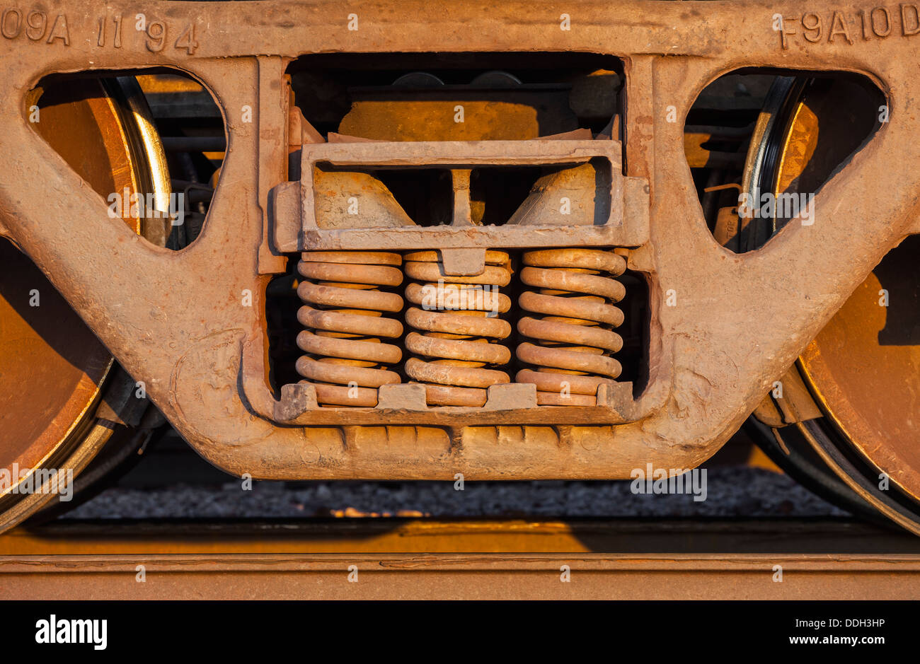 Wheels And Springs Of Freight Train Boxcar On Railroad Tracks
