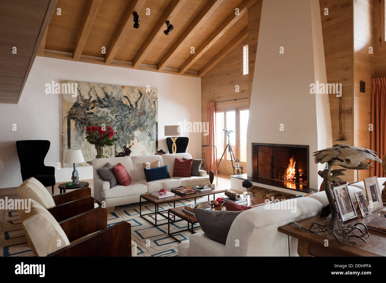 Swiss chalet with interior designed by tino zervudachi for Swiss chalet house designs