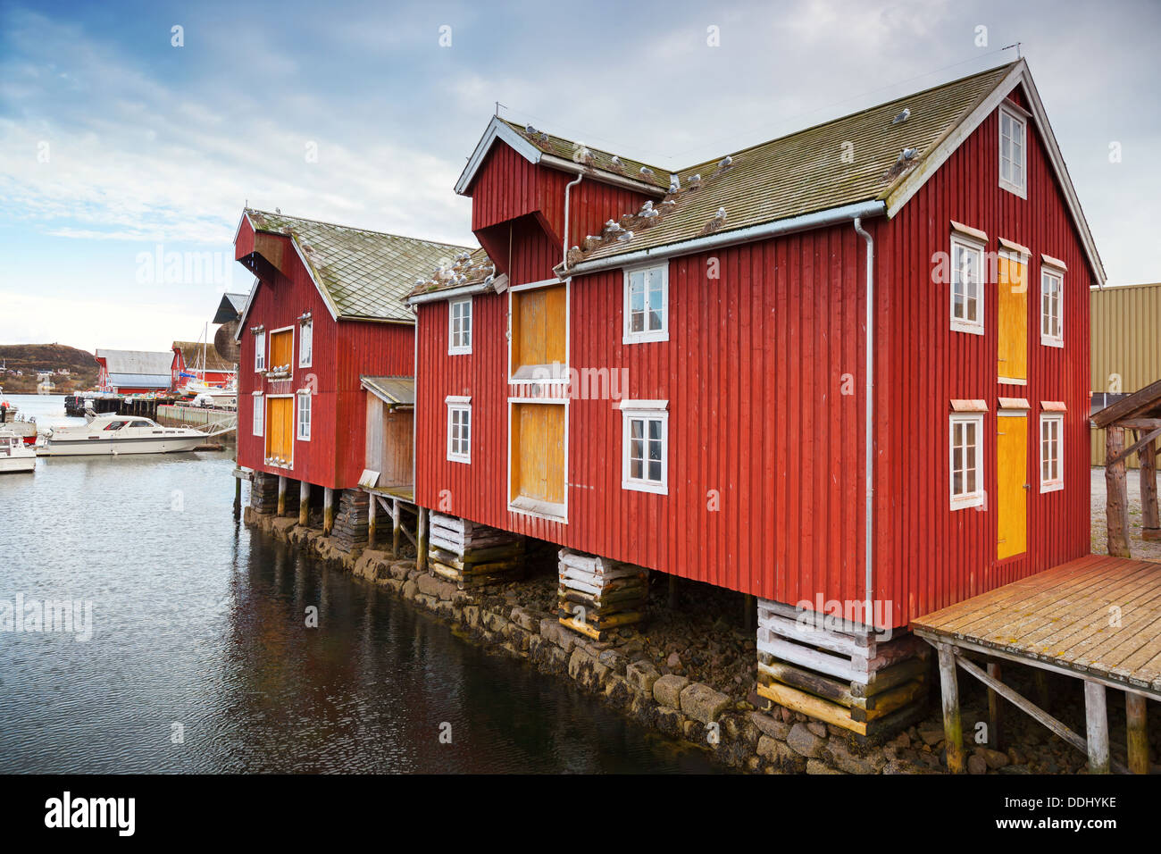 red and yellow wooden coastal houses in norwegian fishing village