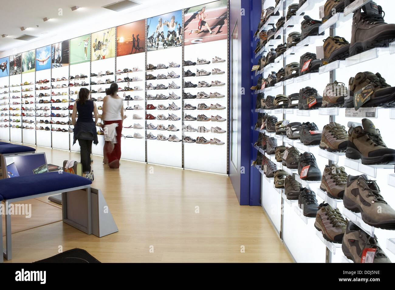sports shoes in shoe shop shopping mall stock photo