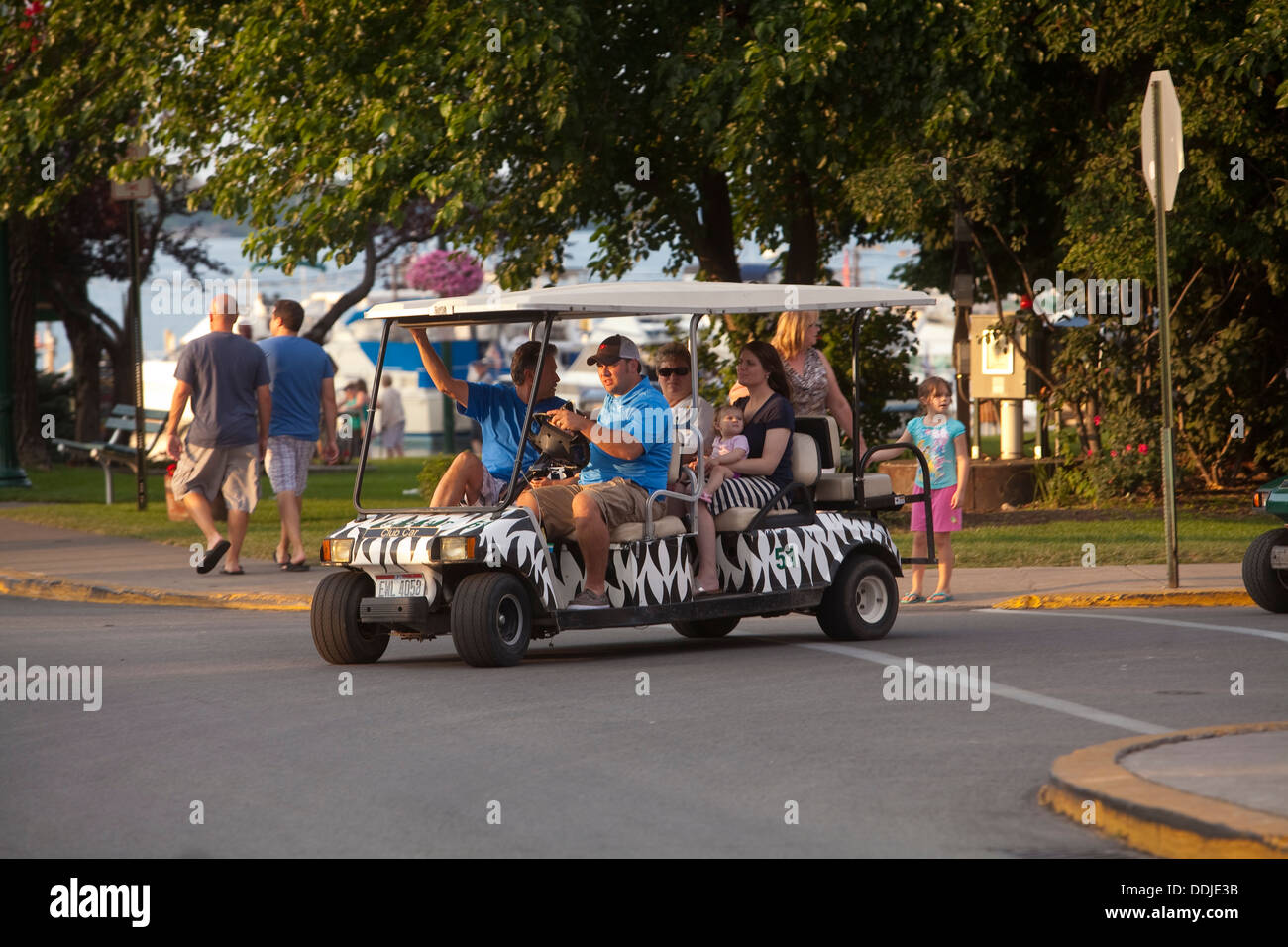 A Man Drives A Golf Cart In Downtown Put In Bay On South