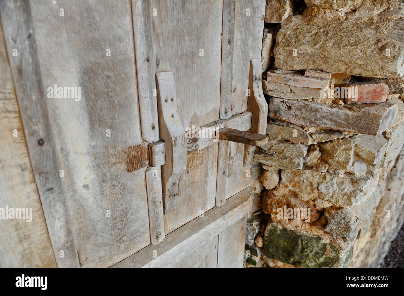 Barn door latches - Old Wooden Barn Door Latch And Inner Stone Wall