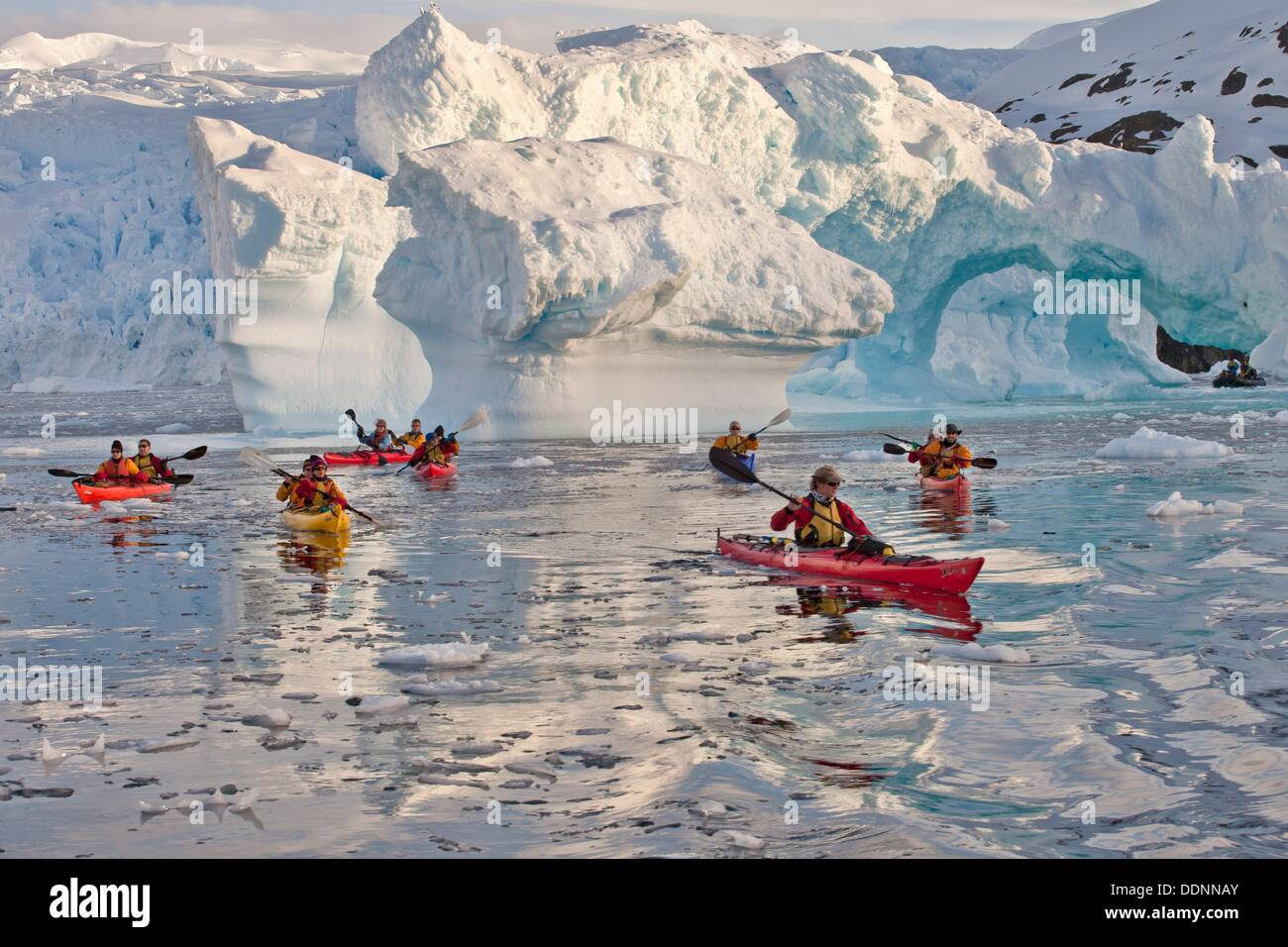 Kayakers Paddle Away From Iceberg Arch Cierva Cove