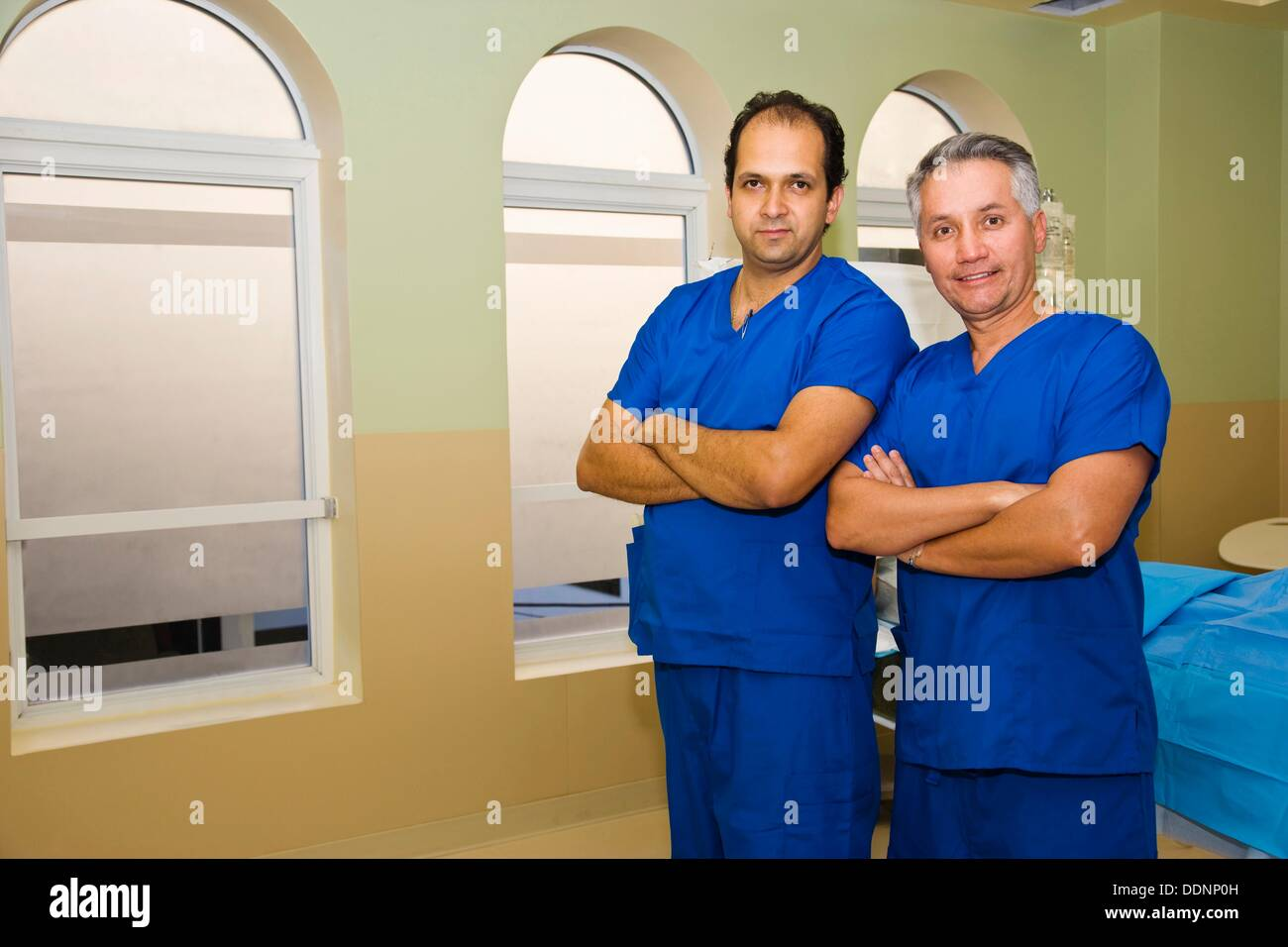 Two Male Plastic Surgeons In Surgery Room West Palm Beach Florida Usa