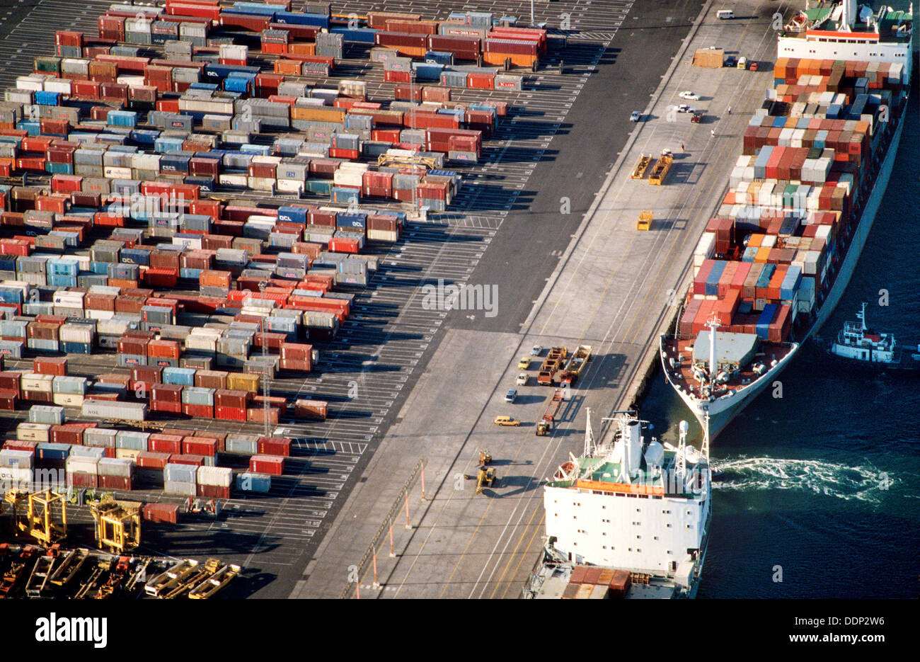 Aerial View Container Ships In Dock Against Container Storage Yards