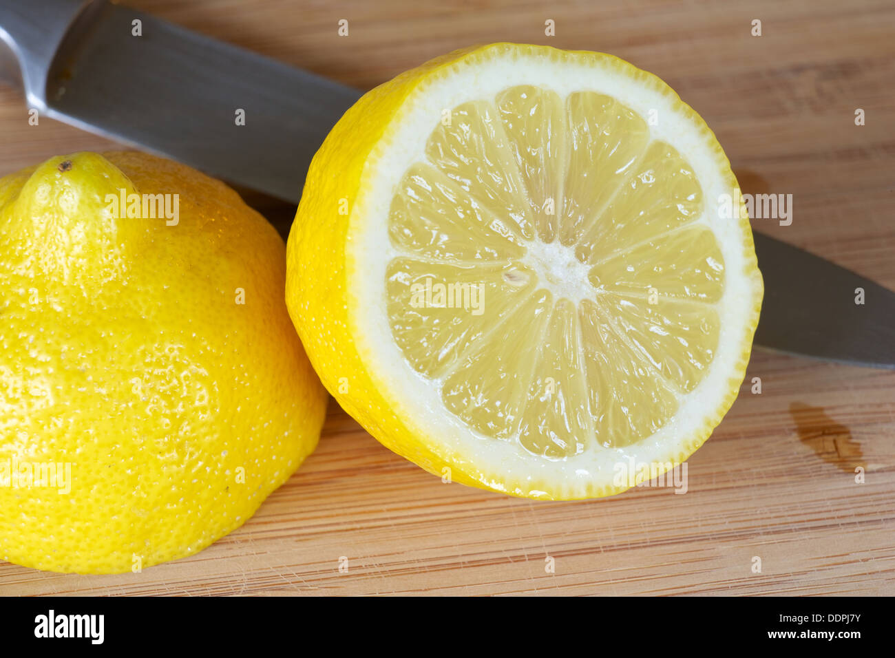 Lemon cut open with knife on a cutting board Stock Photo ...