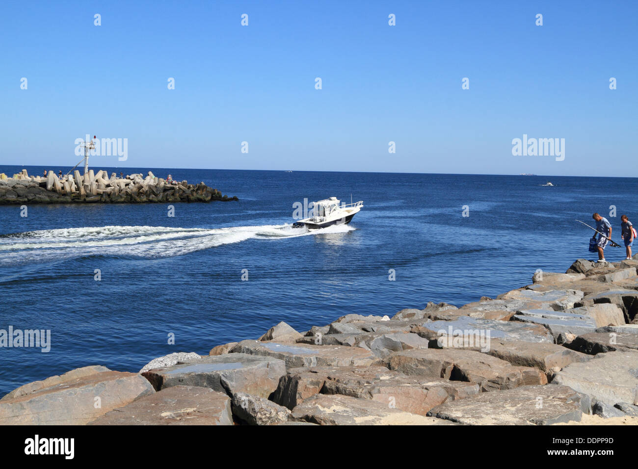 A fishing boat leaving the manasquan inlet into the for Manasquan inlet fishing