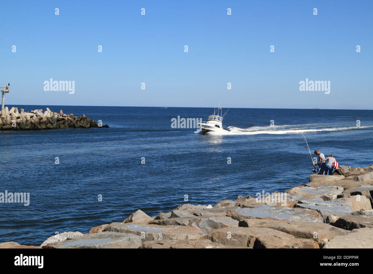 a fishing boat entering the manasquan inlet from the
