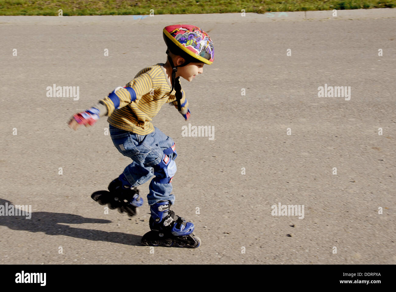 Roller skating quebec city - 5 Year Old Boy Learns How To Roller Blade Wearing Protective Safety Equipment Stock Image