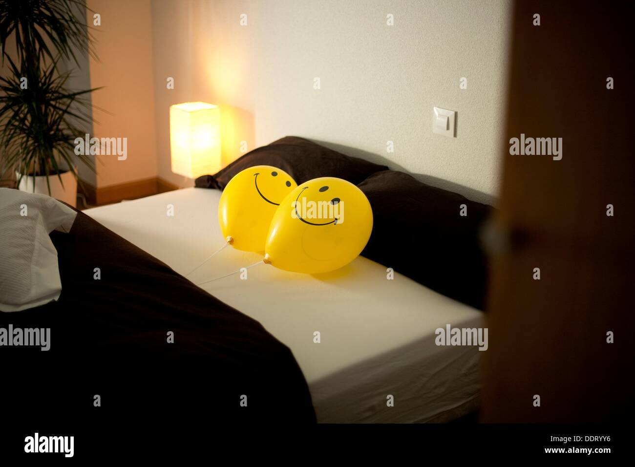 Yellows balloons bedroom japanese decoration stock photo for Bed decoration with balloons