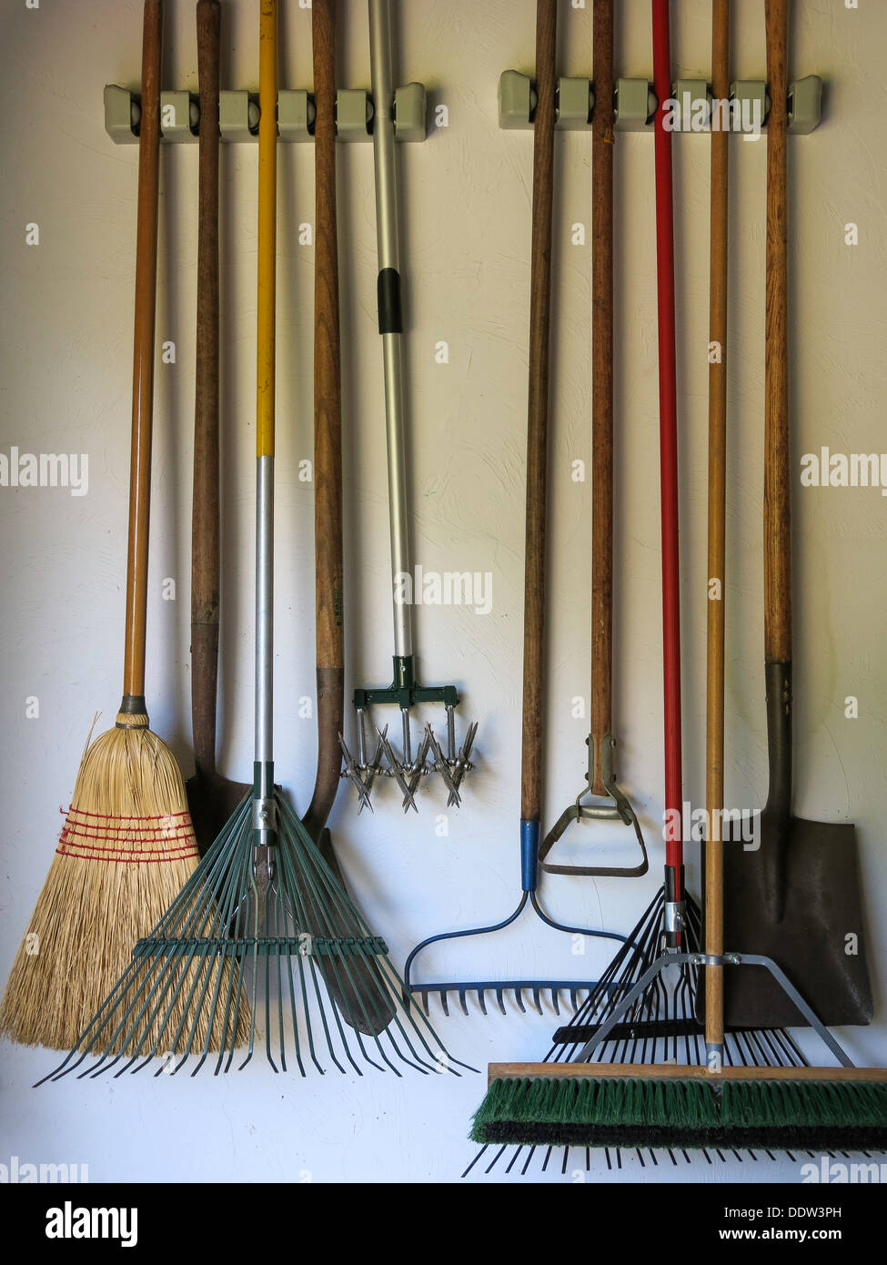 Lawn and garden tools hanging in garage usa stock photo for Lawn and garden implements