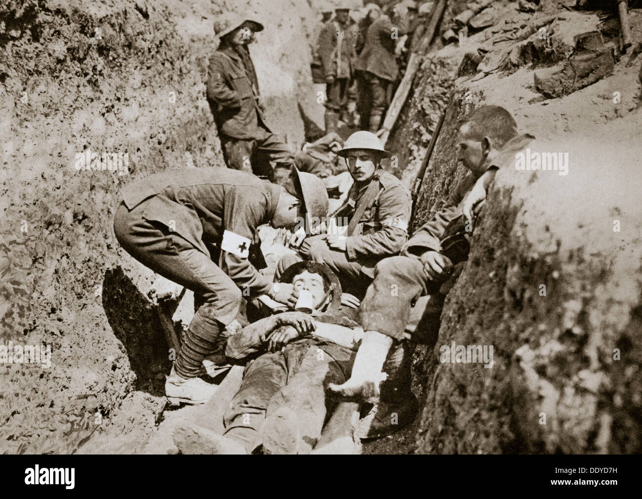 red cross men in the trenches tend a wounded man somme campaign stock photo royalty free image. Black Bedroom Furniture Sets. Home Design Ideas