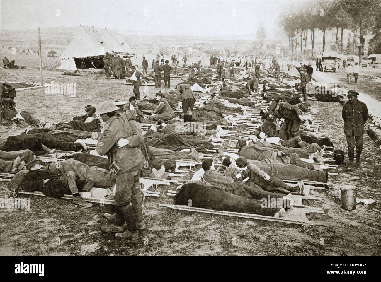 wounded men waiting to be taken away to a clearing station france stock photo royalty free. Black Bedroom Furniture Sets. Home Design Ideas