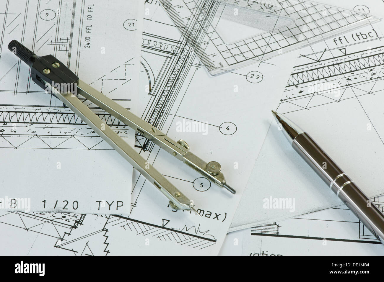 Compasses Pen And Set Square On Some House Plans Stock