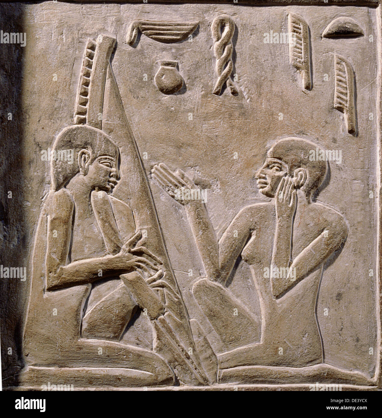 A Relief On The False Door Of Nikaure Showing Two Women Singing And Playing  The Harp.