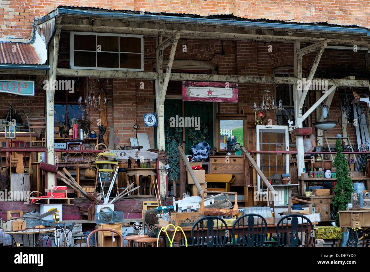 outdoor shot of antique store with many of the antiques in front