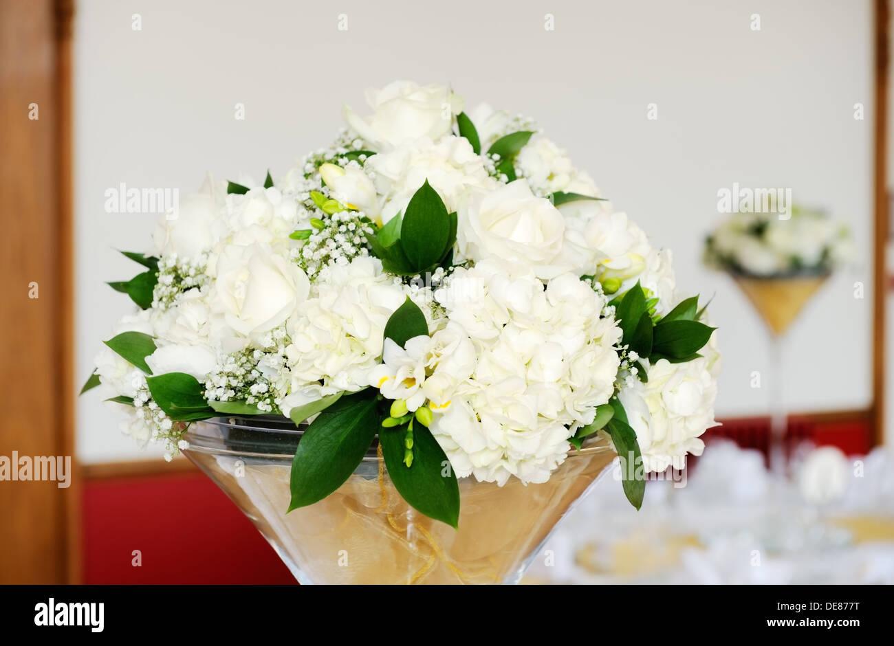 wedding reception white floral arrangements decorating tables