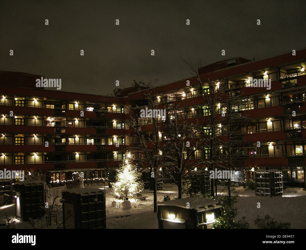Apartment Building At Night apartment building and courtyard in snow at night stock photo