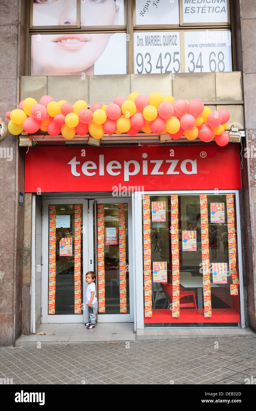 Catalan flag made of balloons on the door of a Telepizza Stock ...