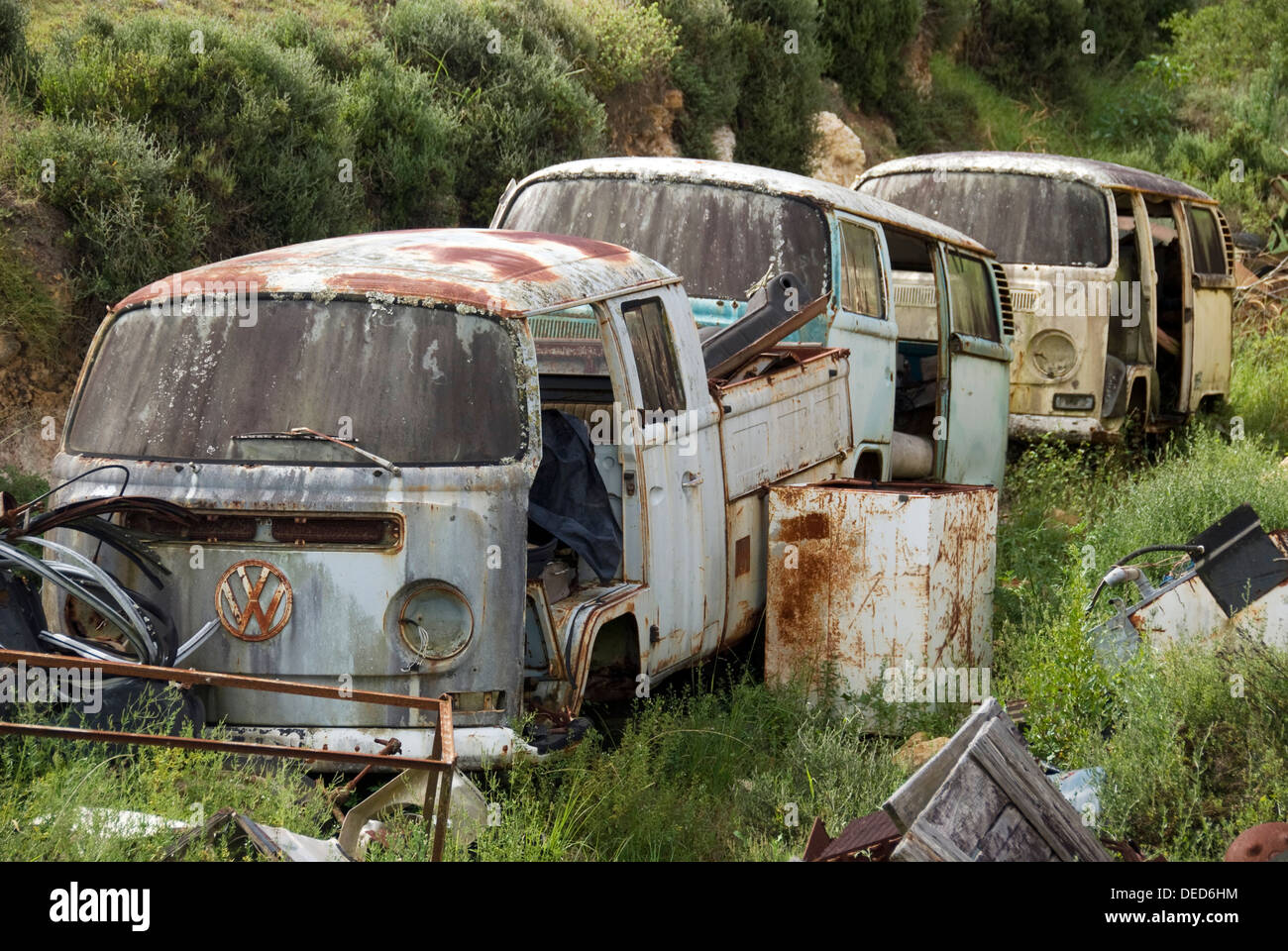 A Row Of Old Rusted Camper Vans