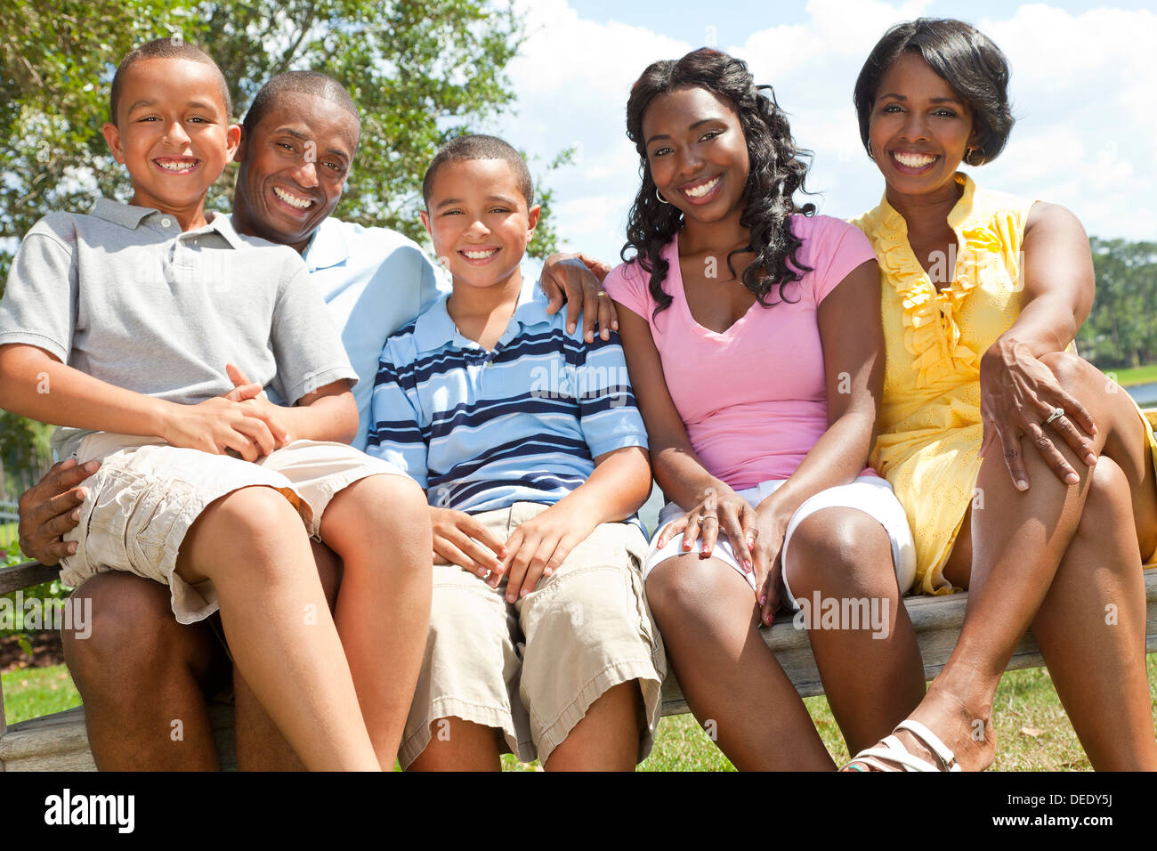 A happy black African American family of two parents and ...
