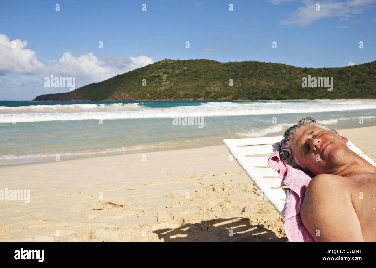 flamenco beach beautiful strong waves man on white chaise lounge