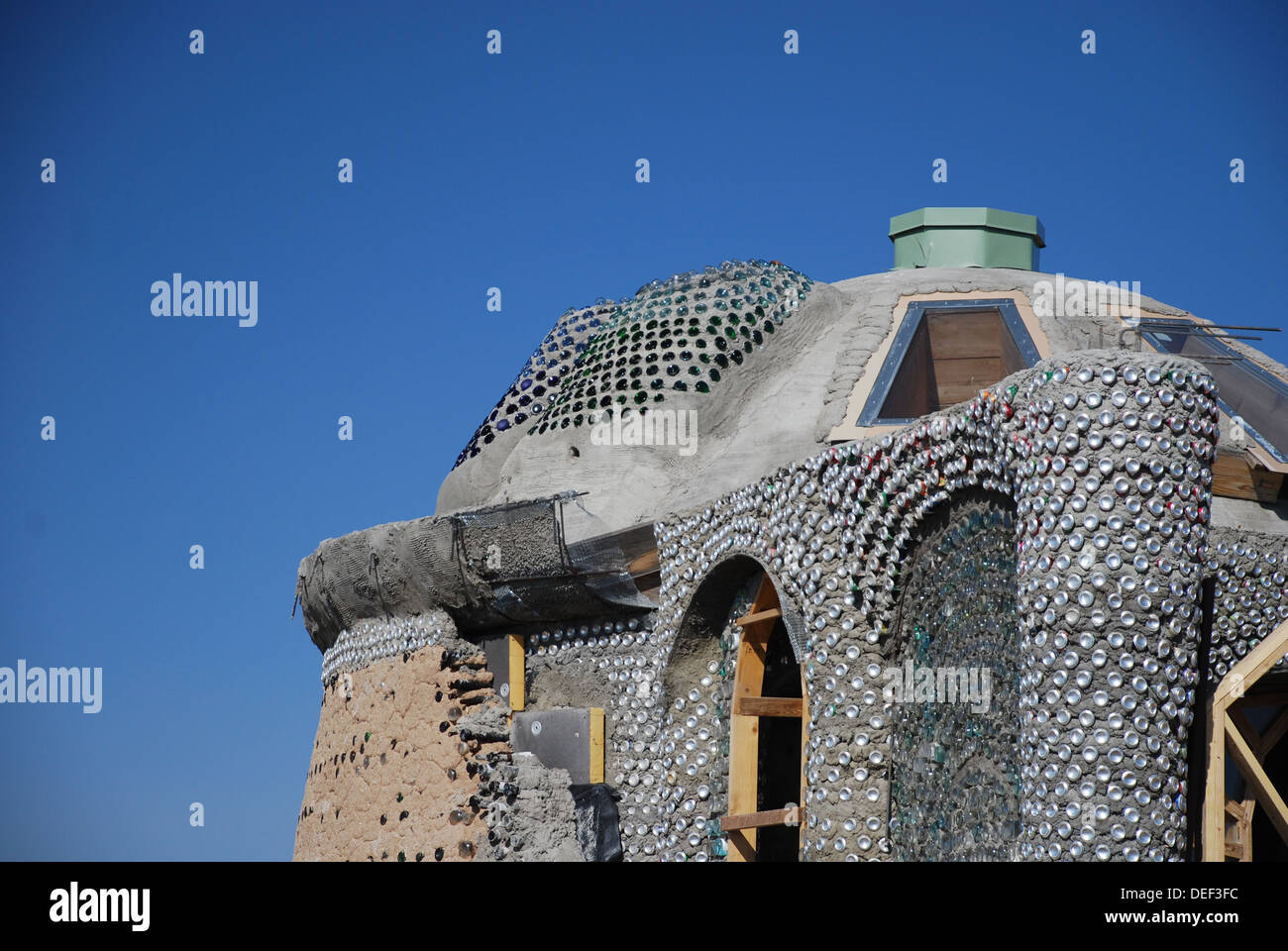 Earthship Green Home Using Recycled Rubber Tires And Glass Bottles