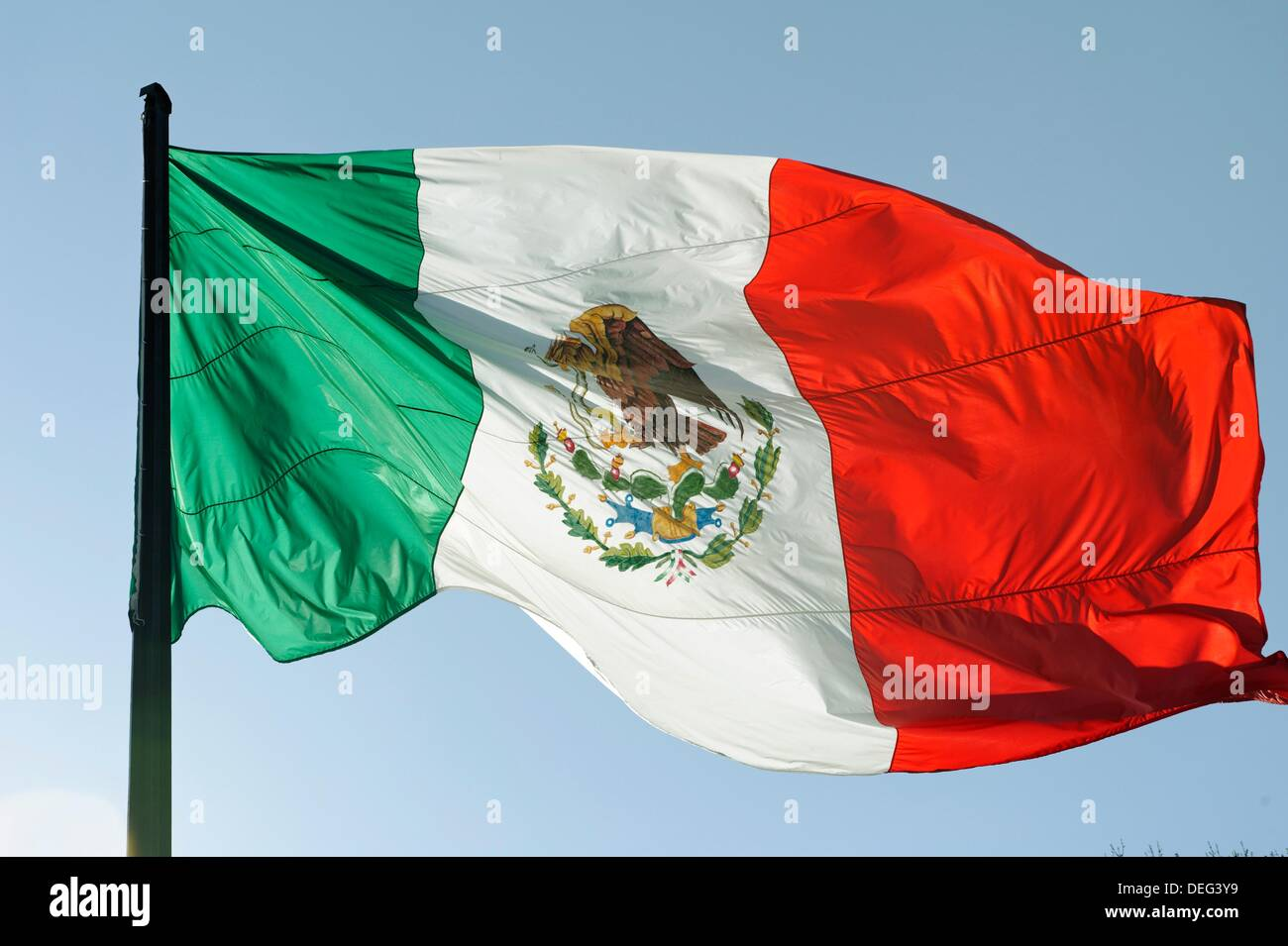 the flag of mexico is a vertical tricolor of green white and red