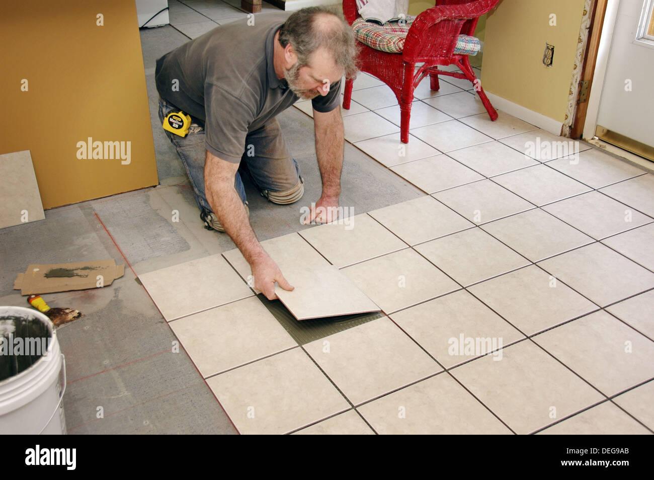 Putting down tile floor
