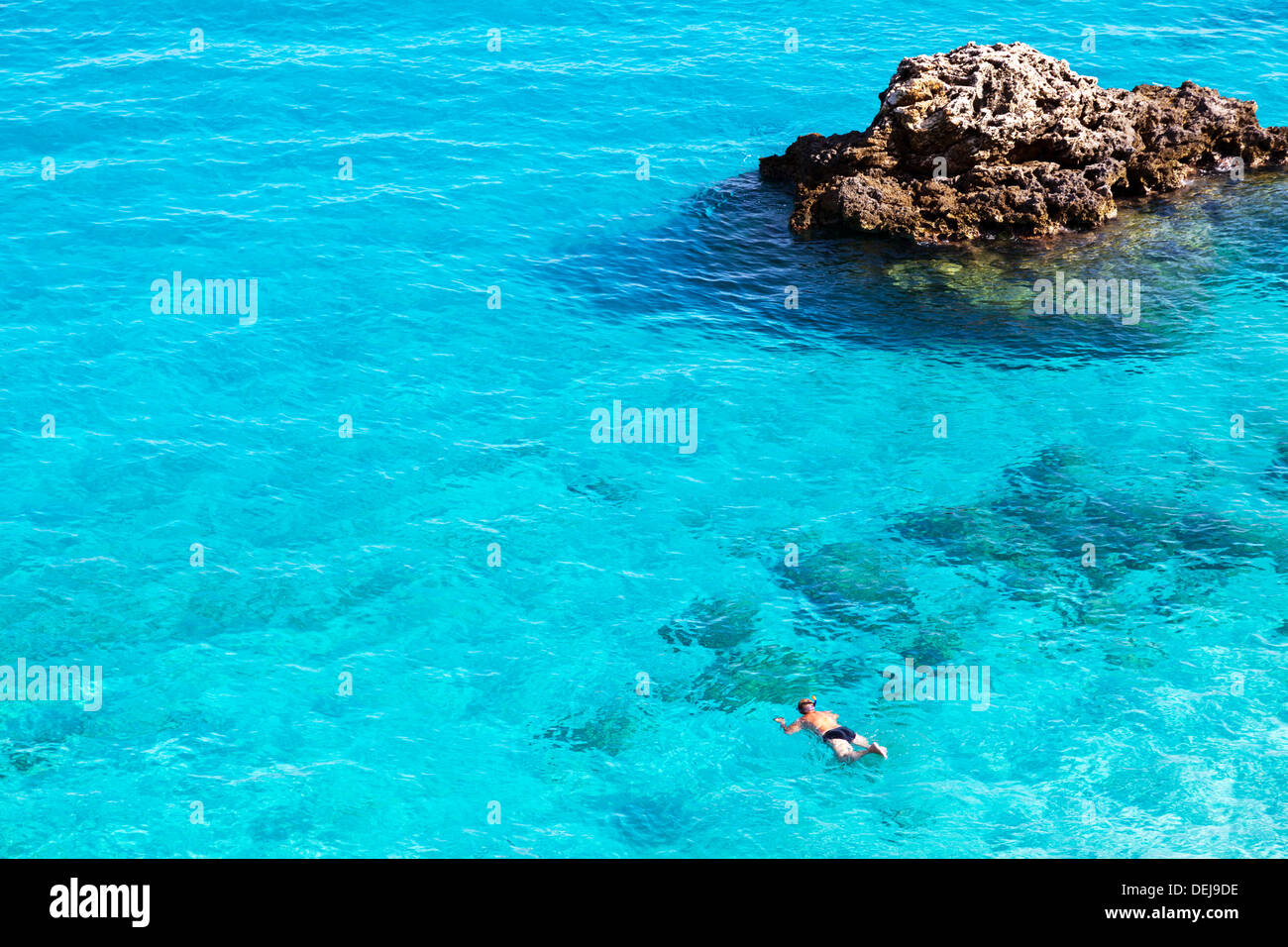 Amazing blue turquoise sea water man snorkeling at Ag ... - photo#3
