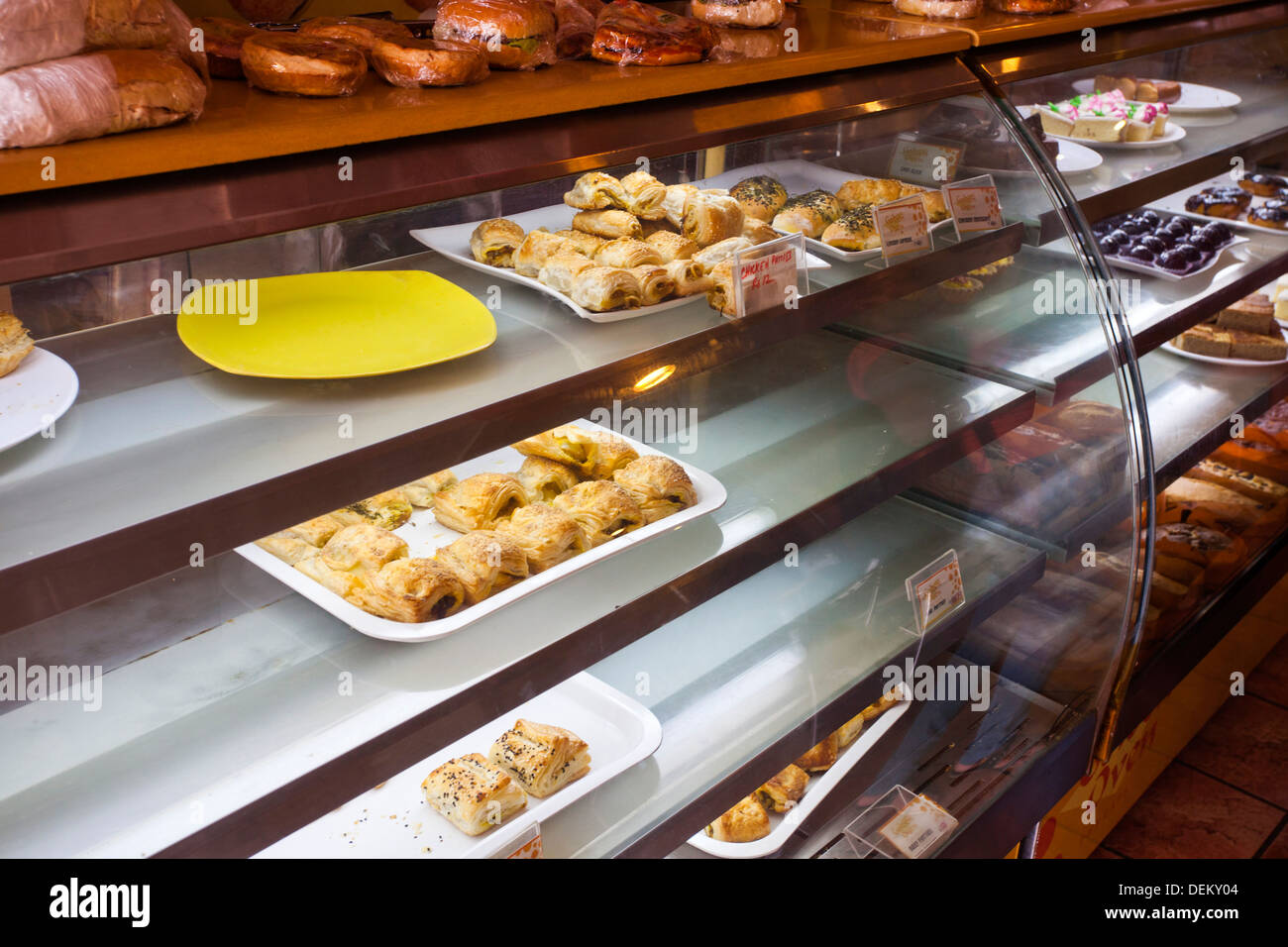 Close-up of bakery products in display cabinet, Golden Oven Cake ...