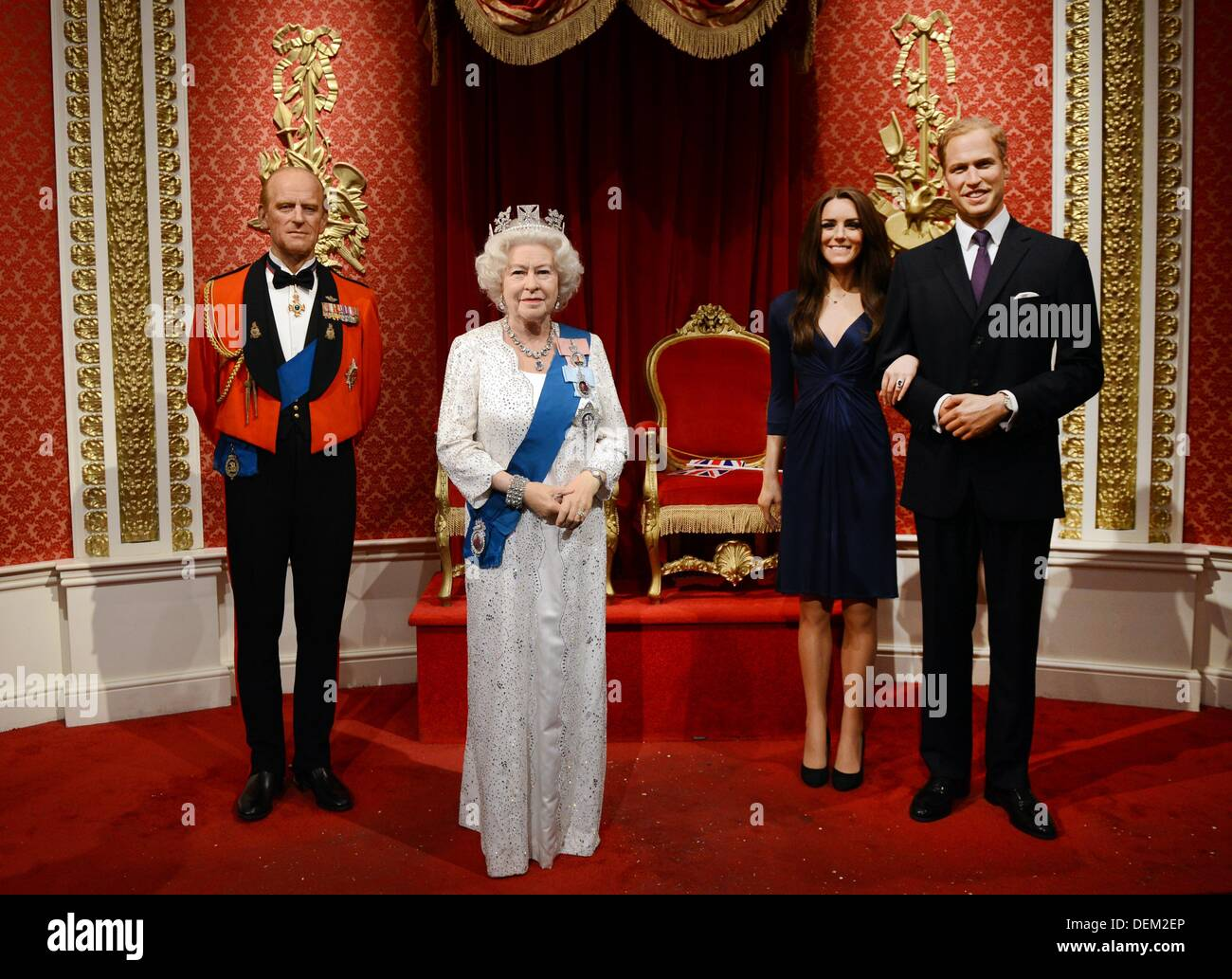 The wax figures of prince philip duke of edinburgh l r queen elizabeth ii catherine duchess of cambridge and prince william duke of cambridge stand