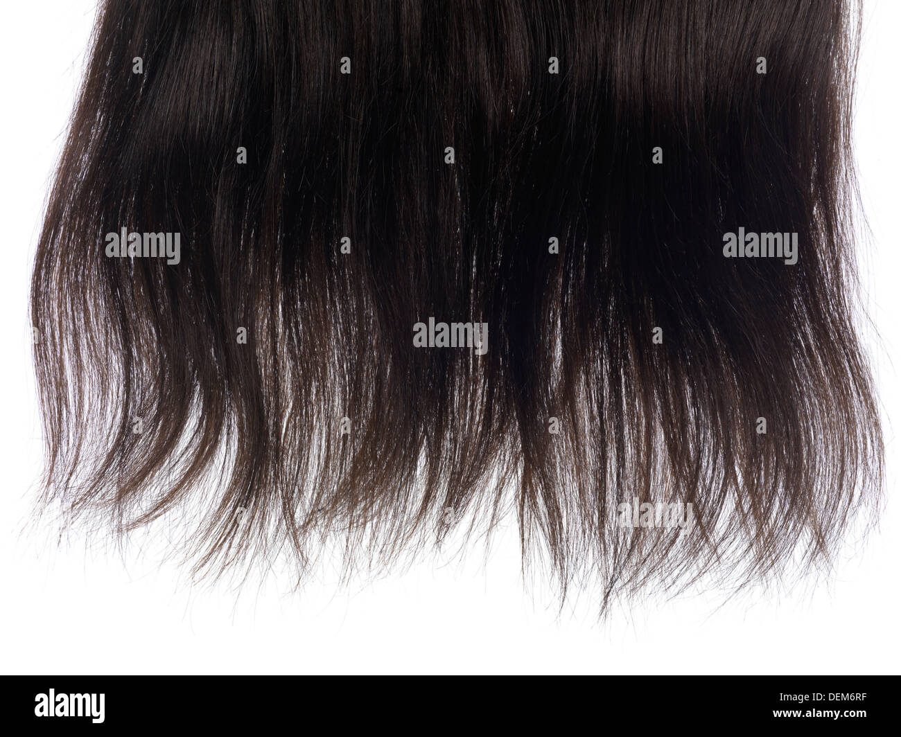lock of brown hair extensions with real hair isolated texture