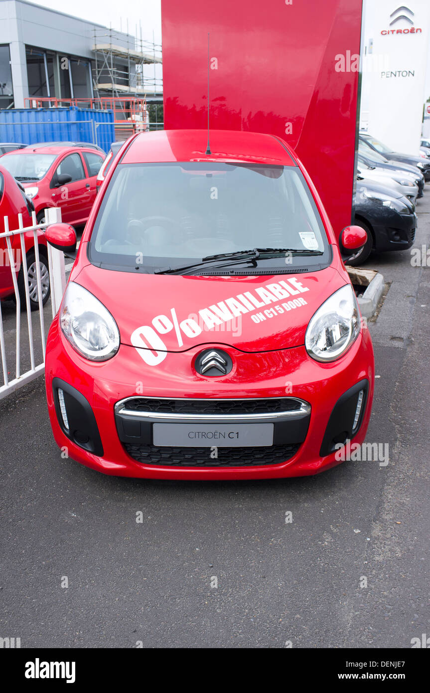 New red citroen c1 car for sale at uk car dealer with 0 finance offer in white lettering stickers on bonnet