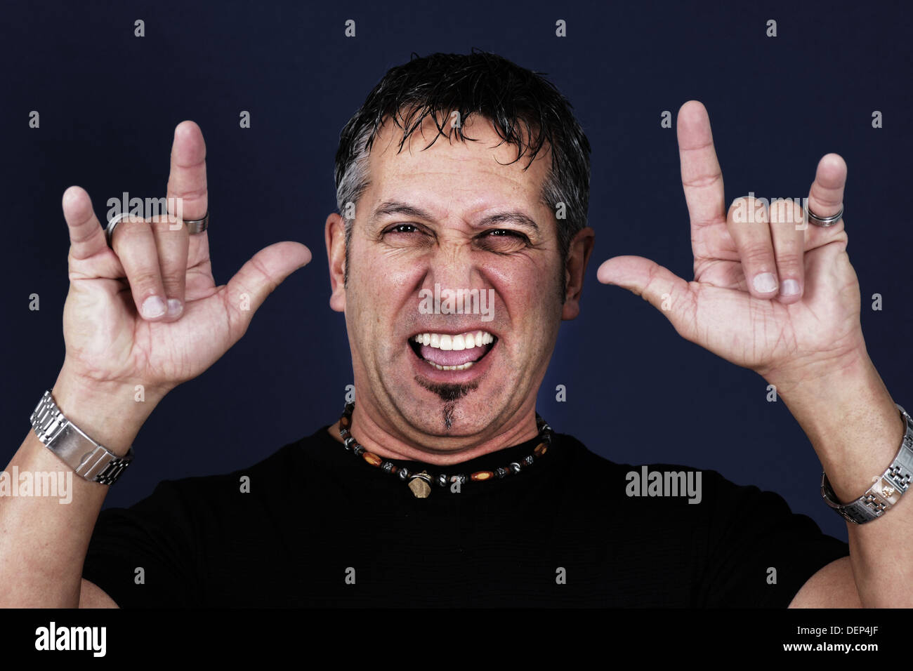 Middle aged man making the devil hand gesture or symbol stock middle aged man making the devil hand gesture or symbol buycottarizona