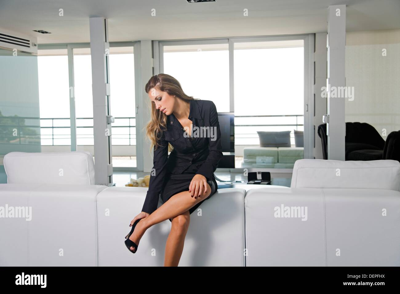 Young Business Woman Arriving Home And Taking Out Her