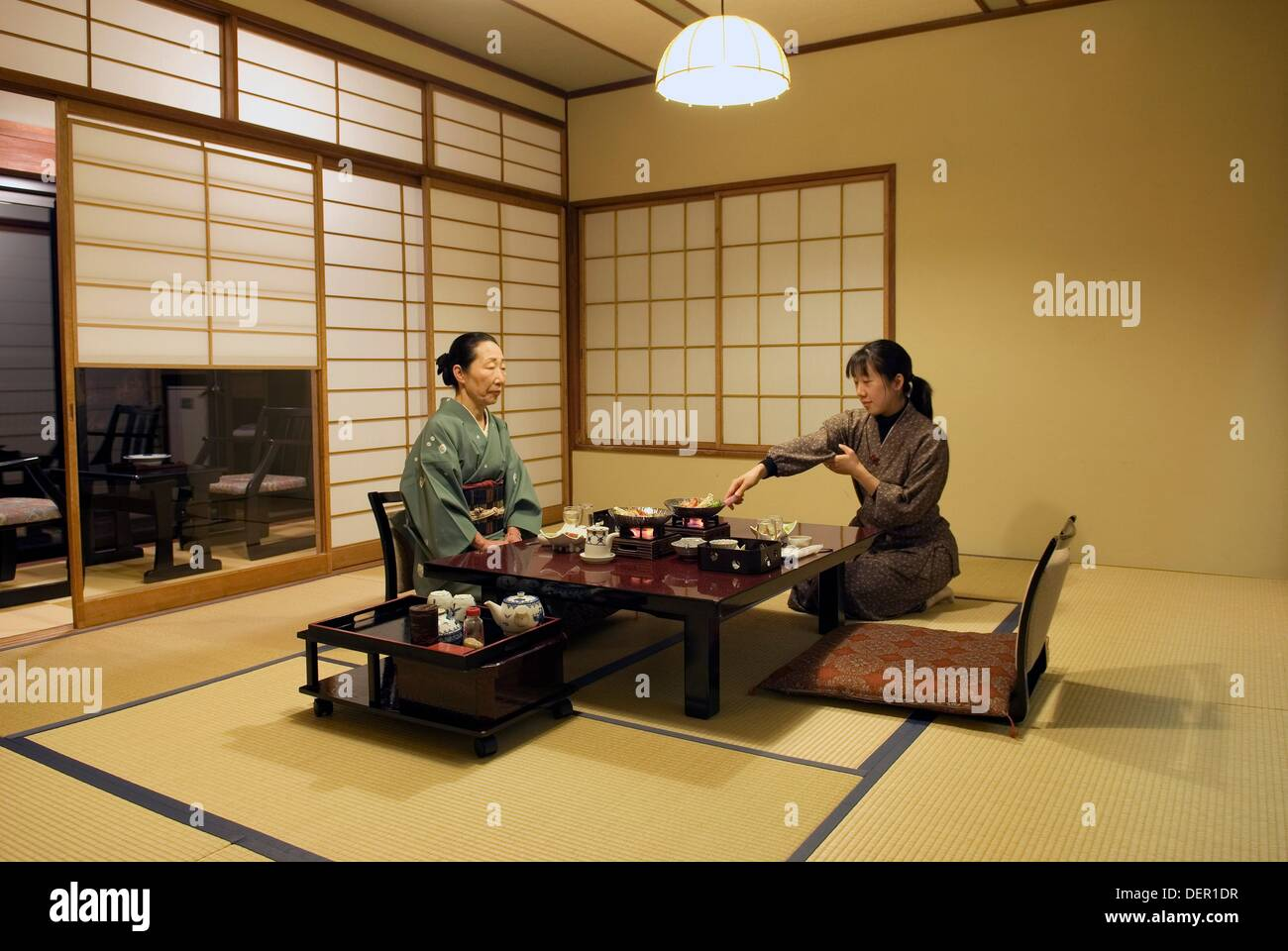 Traditional Japanese Bedroom waitress serving evening meal in bedroom in a traditional japanese