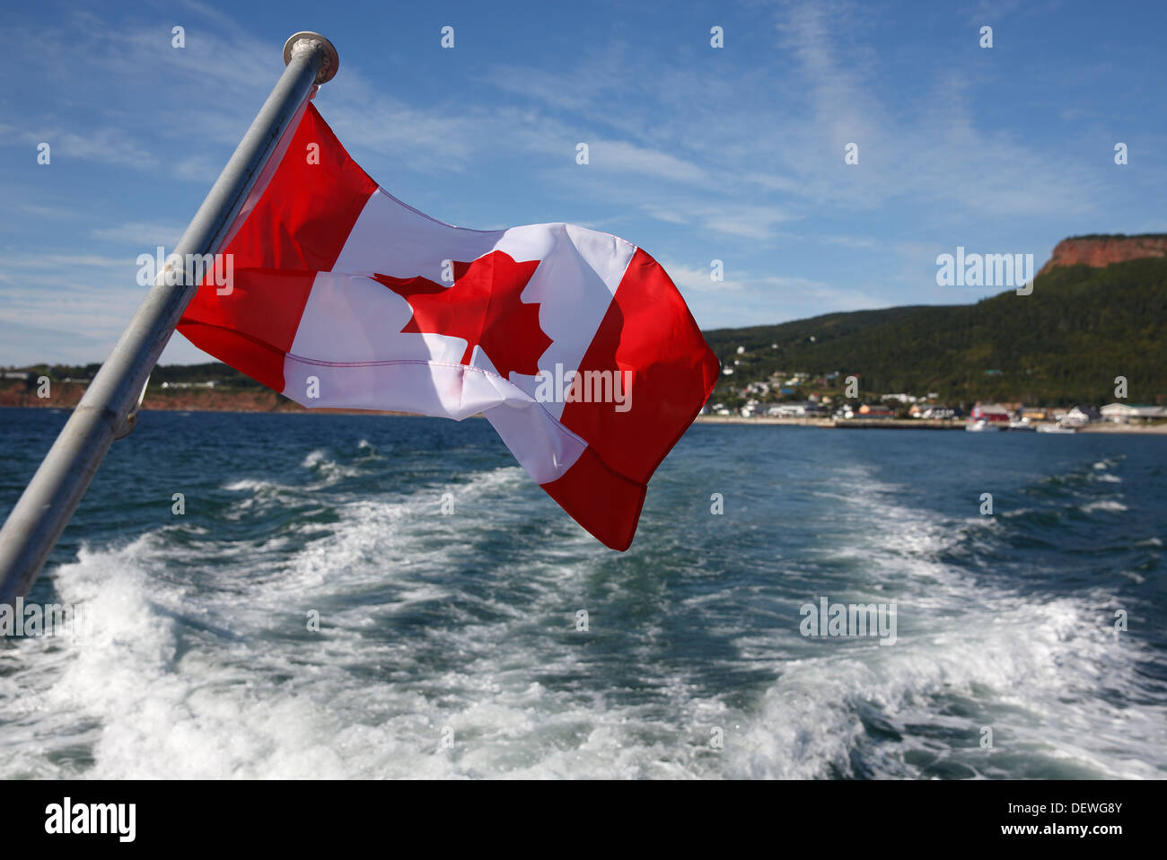 canadian flag flying from stern of a boat percé québec canada