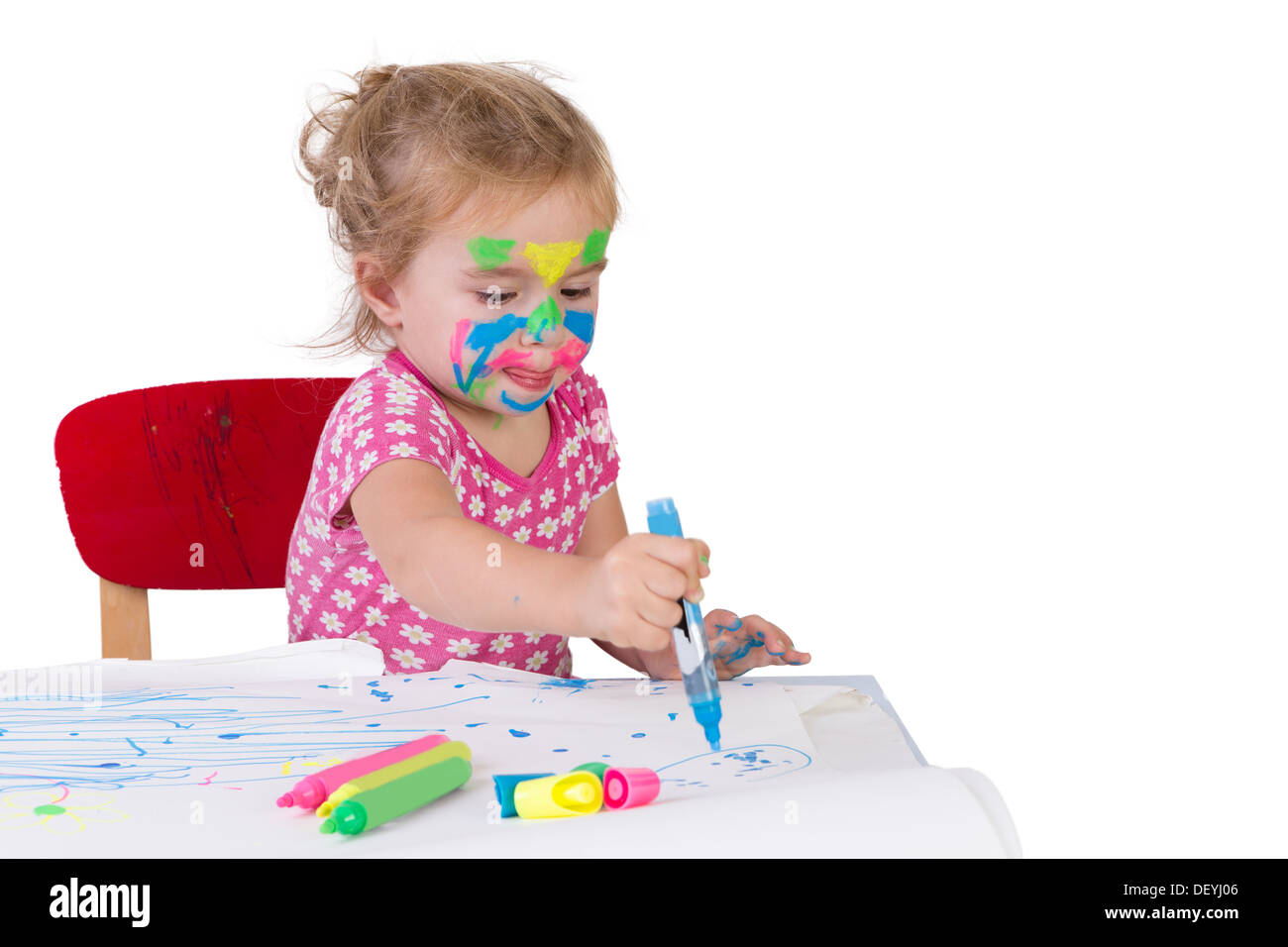 Toddler girl learning how to draw with coloring markers, her face ...