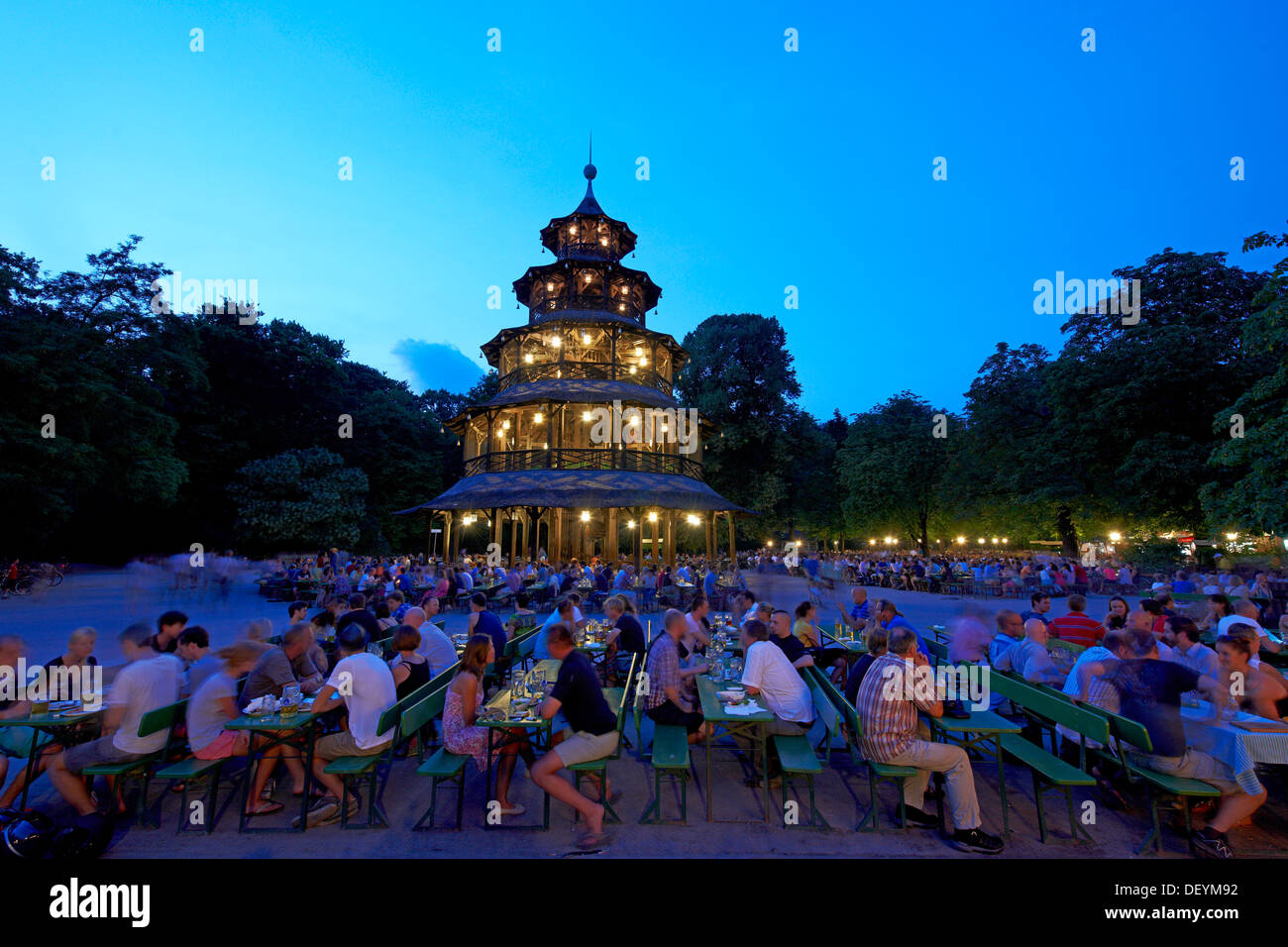 beer garden at the chinese tower in the english garden munich upper stock photo royalty free. Black Bedroom Furniture Sets. Home Design Ideas
