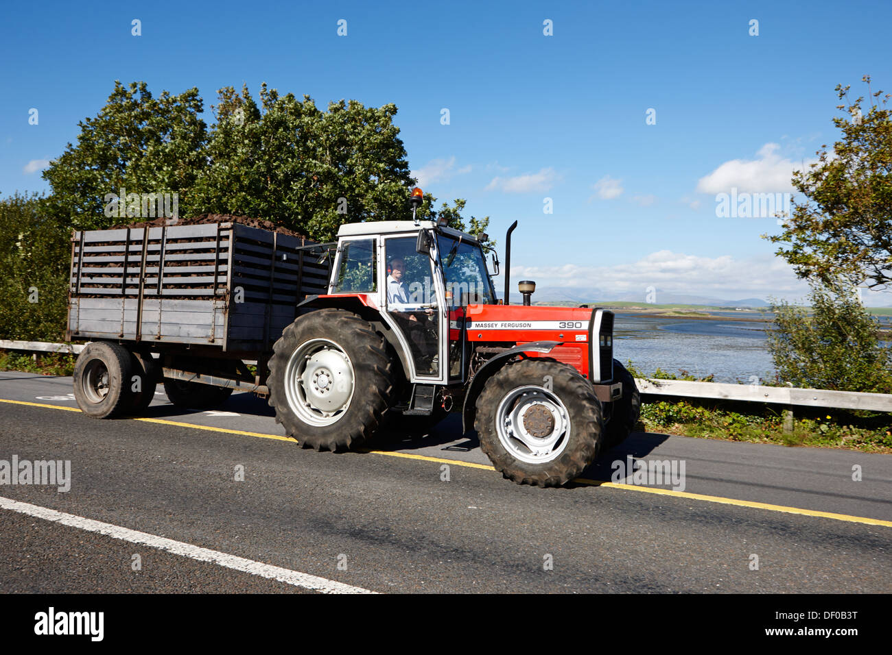 Tractor Pulling Trailer : Tractor towing trailer of cut dried turf for winter fuel