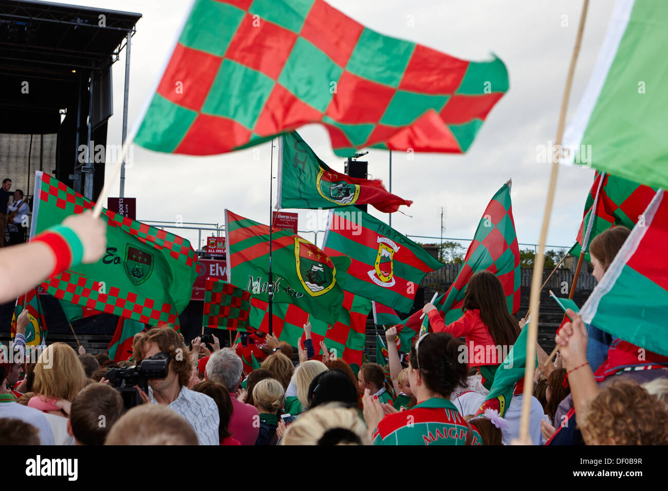 county mayo gaa fans with county flags at a game republic of