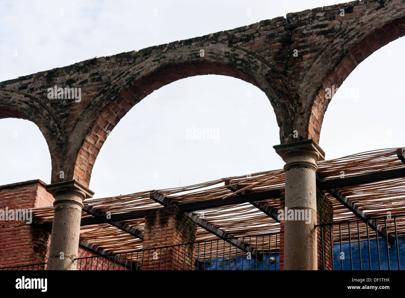 Brick Arches Stone Columns And A Rustic Sun Screen On An